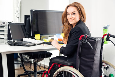 A woman seated at a computer